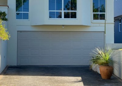 Sectional garage door panels